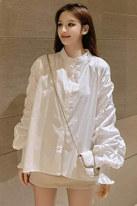实拍2020春季新款宫廷风小立领泡泡袖褶皱前短后长衬衫女